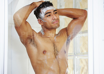 Buy stock photo Shot of a young man washing his hair in the shower