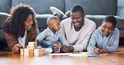 Buy stock photo Shot of a family playing together in the lounge at home