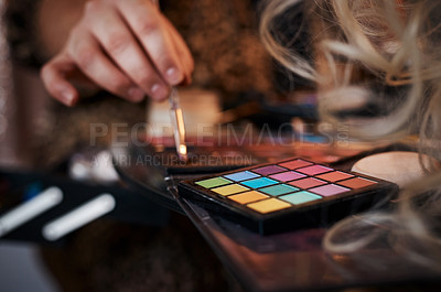 Buy stock photo Cropped shot of an unrecognizable man using eyeshadow in a studio