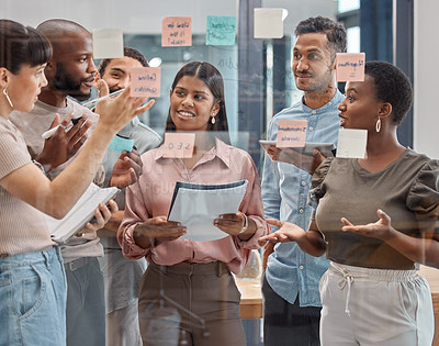 Buy stock photo Shot of a group of young businesspeople having a discussion at the office