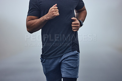 Buy stock photo Closeup shot of an unrecognisable man running outdoors