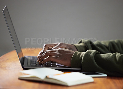 Buy stock photo Shot of an unrecognizable person using a laptop in an office