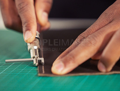 Buy stock photo Cropped shot of an unrecognizable male designer working with leather in his design studio