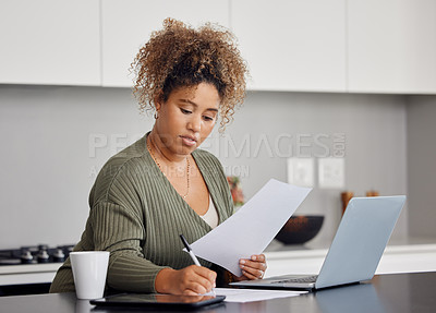 Buy stock photo Shot of a woman filling in some paperwork at home