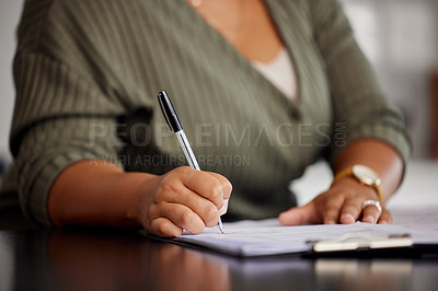 Buy stock photo Unrecognizable shot of a woman doing some paperwork at home