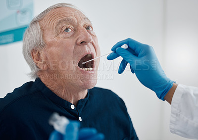 Buy stock photo Cropped shot of an unrecognizable doctor testing a senior male patient for covid