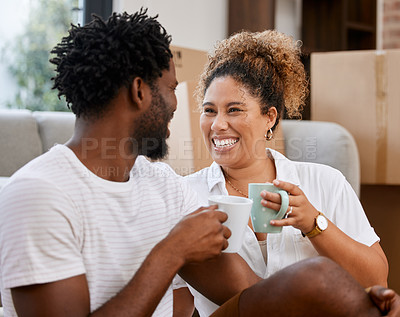 Buy stock photo Shot of a couple drinking coffee in their new home