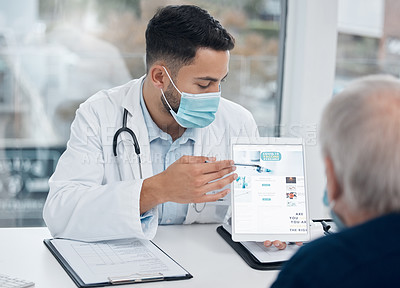 Buy stock photo Shot of a young doctor showing a patient information on a digital tablet in an office