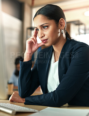 Buy stock photo Shot of a young businesswoman experiencing a headache at work