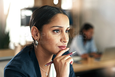 Buy stock photo Shot of a young businesswoman at her desk in the office