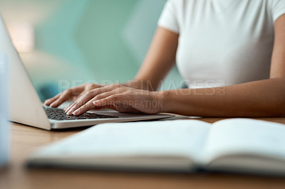 Buy stock photo Shot of an unrecognizable woman using a laptop at home