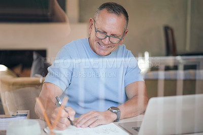 Buy stock photo Shot of a mature man making notes while working