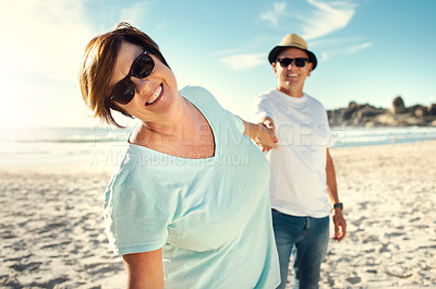 Buy stock photo Shot of a mature couple spending the day at the beach