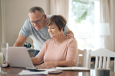 Buy stock photo Shot of a mature husband and wife using a laptop together