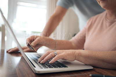 Buy stock photo Shot of a woman using her card to shop online