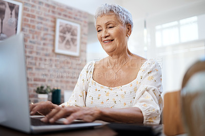 Buy stock photo Shot of a senior woman using a laptop at home