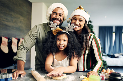 Buy stock photo Shot of a happy young family preparing a meal during Christmas at home