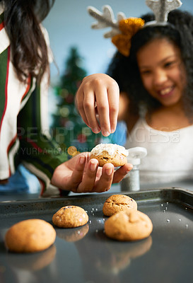 Buy stock photo Shot of a happy young mother and daughter baking during Christmas at home