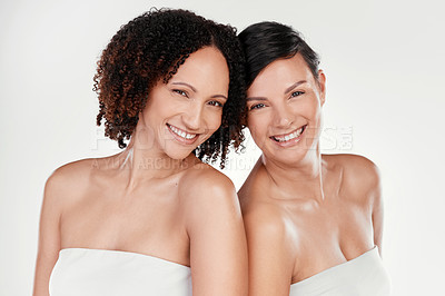 Buy stock photo Cropped portrait of two beautiful mature women posing against a grey background in studio