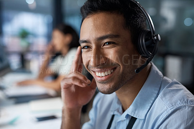 Buy stock photo Shot of a young man using a headset in a modern office