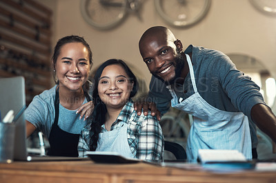 Buy stock photo Portrait of three young working using a laptop at work