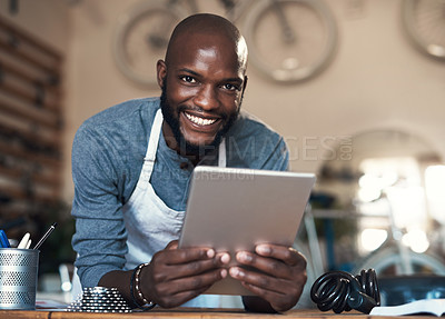 Buy stock photo Portrait of a young man using a digital tablet at work
