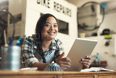 Buy stock photo Portrait of a young woman using a digital tablet at work