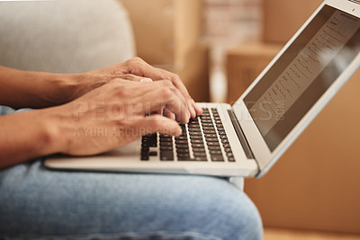 Buy stock photo Shot of an unrecognizable person using a laptop at home