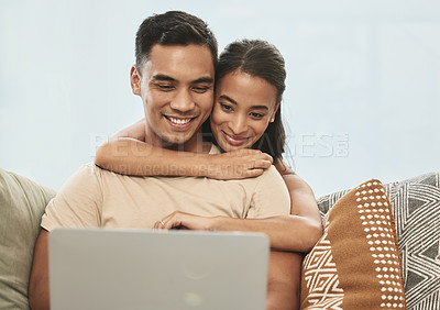 Buy stock photo Shot of a couple using a laptop at home