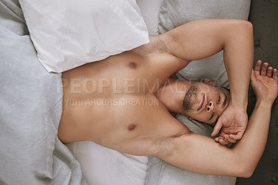 Buy stock photo High angle portrait of a handsome and muscular young man lying in his bed at home
