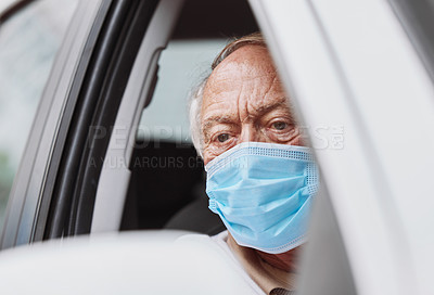 Buy stock photo Shot of a senior man waiting to get vaccinated at a drive through vaccination site