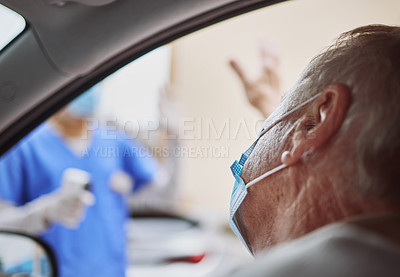 Buy stock photo Shot of a senior man waving at a healthcare worker while in his car at a drive through vaccination site
