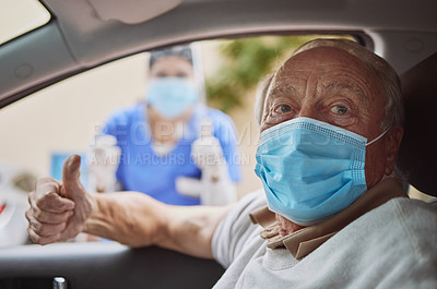 Buy stock photo Shot of a senior man and a young healthcare worker showing a thumbs up at a drive through vaccination site
