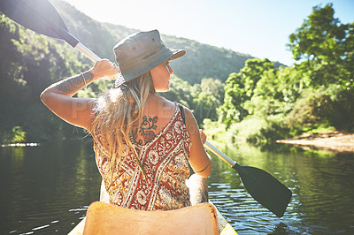 Buy stock photo Shot of a young woman out kayaking on a lake