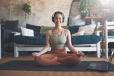 Buy stock photo Portrait of a young woman using a laptop while practising yoga at home