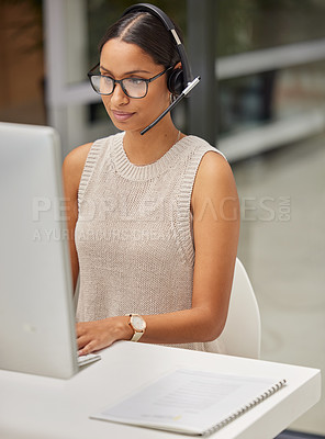 Buy stock photo Shot of a businesswoman using a computer while working in a call center