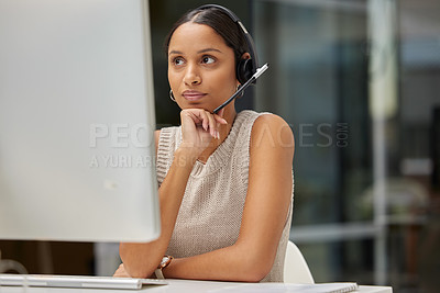 Buy stock photo Shot of a young businesswoman working in a call center