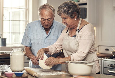 Buy stock photo Shot of a senior couple baking together at home
