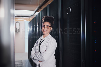 Buy stock photo Portrait of a young beautiful woman with folded arms working in server room