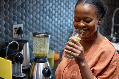 Buy stock photo Shot of a young woman making a healthy smoothie at home