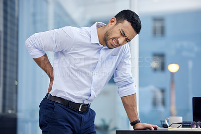 Buy stock photo Shot of a businessman suffering from backache at work