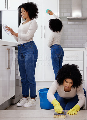 Buy stock photo Shot of a young woman cleaning the house