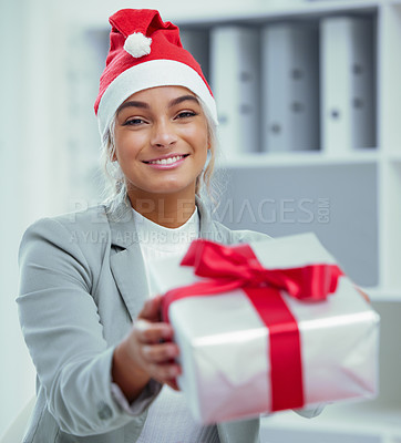Buy stock photo Portrait of a young beautiful woman spreading Christmas cheer with gifts at the office