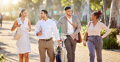 Buy stock photo Shot of a diverse group of businesspeople walking through the city together after work