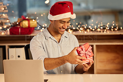 Buy stock photo Shot of a young businessman celebrating Christmas at work