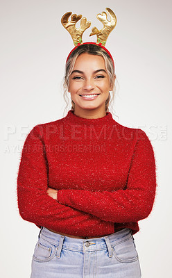 Buy stock photo Studio shot of a young woman wearing a reindeer headwear against a grey background