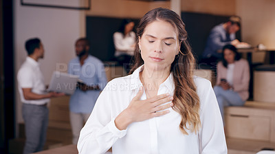 Buy stock photo Shot of an attractive young businesswoman standing in the office and suffering from a congested chest