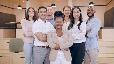 Buy stock photo Shot of a diverse group of businesspeople standing in the office together with their arms folded