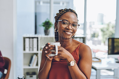 Buy stock photo Portrait of a young businesswoman drinking coffee in an office