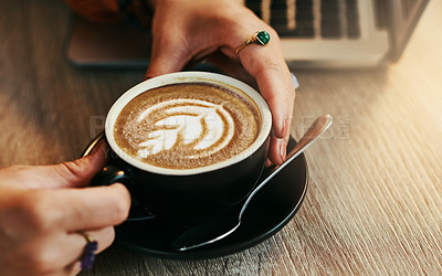 Buy stock photo Shot of a woman enjoying a cup of coffee